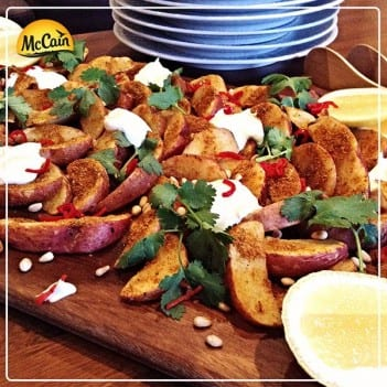 Spice Roasted Potatoes. Sweet Potato Wedges Baked In Spices, Served With Toasted Pinenuts, Lemon Cheeks, Coriander And Greek Yoghurt Drizzle